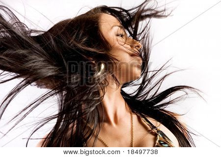 Woman with hair billowing on white background