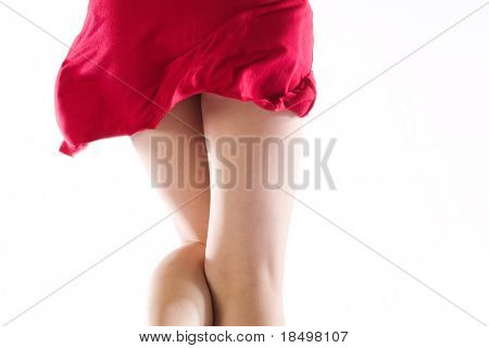 Cheeky red dress flicking up from behind,