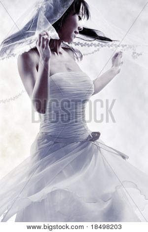 Bride dressing in white spins around happy