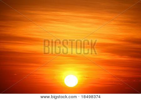 Sun rising into empty sky