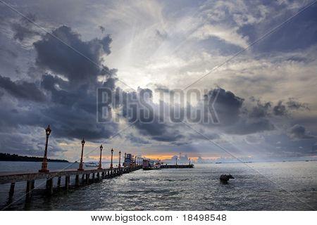 Sun rays shining through spectacular clouds over ocean