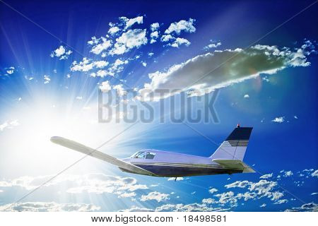 Small plane flying through sky with sun in background