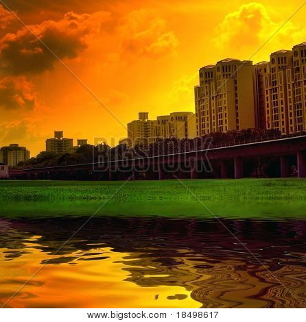 Singapore scene with vivid colors, lake and sunset in background