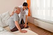 foto of nurse  - a nurse in aged care for the elderly in nursing homes - JPG