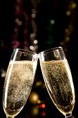 image of champagne glasses  - Champagne glasses making toast over holiday background - JPG