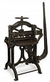 stock photo of lithographic  - Vintage cast iron printing press isolated on white with clipping path - JPG