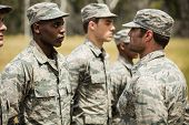 Military trainer giving training to military soldier at boot camp poster