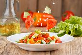 Summer Light Air Salad Of Fresh Vegetables On A Wooden Background. Levitating Salad Ingredients. Sti poster