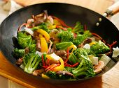picture of chinese wok  - wok full of stirfry with selective focus - JPG