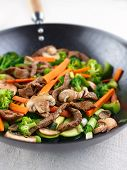 stock photo of chinese wok  - colorful stir fry in a wok - JPG