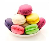 foto of goodies  - Plate of French macaroons on white background - JPG