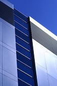 stock photo of commercial building  - Modern office building reflecting the sun - JPG