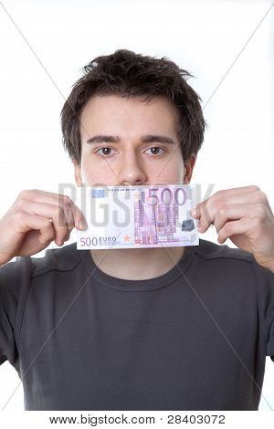 Young Man With A 500 Euro Banknote On His Mouth Isolated Against White Background