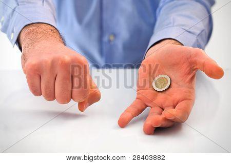 Man handling euro coin.