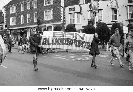 TENTERDEN, ENGLAND - DECEMBER 26: Anti hunt protestors demonstrate in the High Street at the Boxing Day meet of the Ashford Valley Hunt on December 26, 1992 at Tenterden, Kent. Fox hunting was outlawed in 2004.
