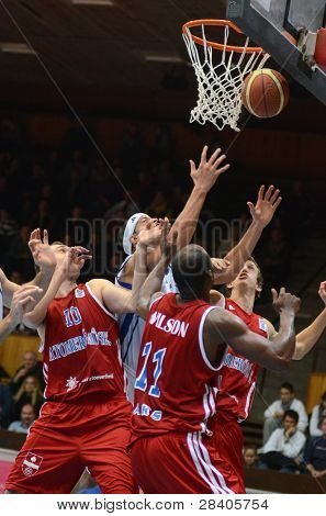 KAPOSVAR, HUNGARY - NOVEMBER 19: Michael Fey (in white) in action at a Hugarian National Championship  basketball game Kaposvar (white) vs. Paks (red) November 19, 2011 in Kaposvar, Hungary.