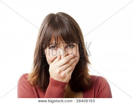 Happy woman having a great surprise and covering her face with the hand, isolated on white backgriund