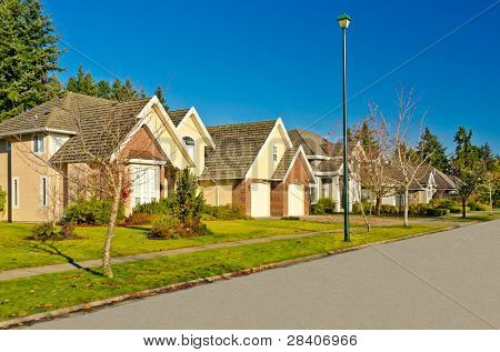 A perfect neighborhood. Houses in suburb at Fall in the north America