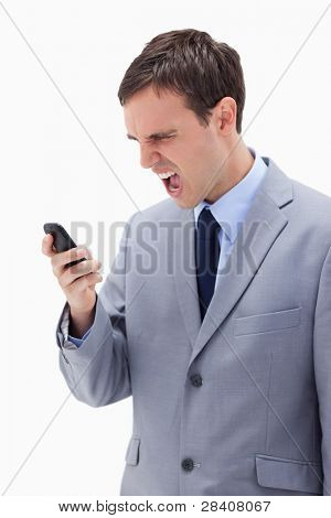 Businessman yelling at his cellphone against a white background