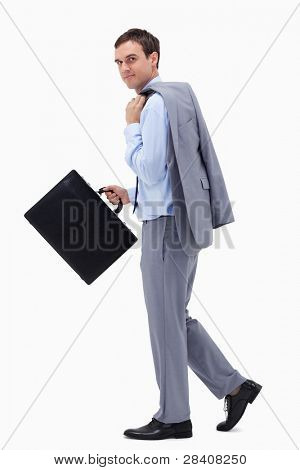 Side view of walking businessman with suitcase against a white background