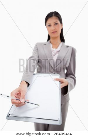 Clipboard and pen being handed over by businesswoman against a white background