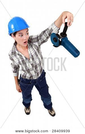 Woman holding an angle grinder