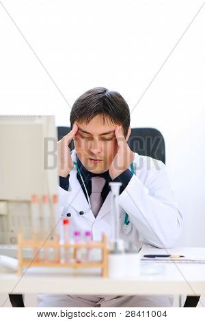 Stressed Medical Doctor Working At Office
