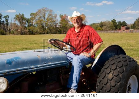 Handsome Rancher On Tractor