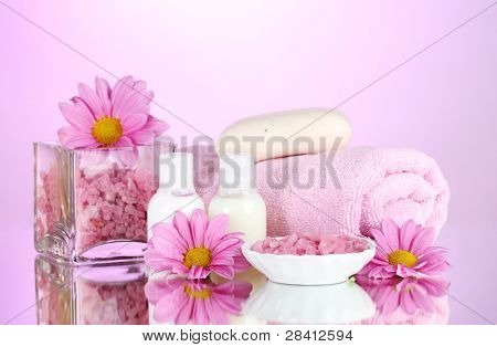Hotel amenities kit on pink background