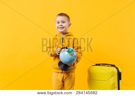 poster of Little Traveler Tourist Kid Boy 3-4 Years Old Isolated On Yellow Orange Wall Background Studio. Pass
