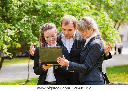 Young business people with laptop