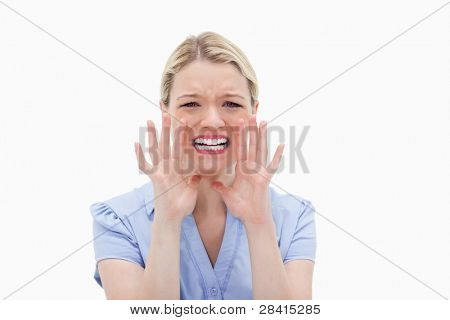 Scared young woman against a white background