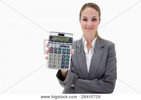 Bank employee showing her pocket calculator against a white background