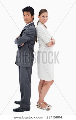 Portrait of business people standing back to back against a white background