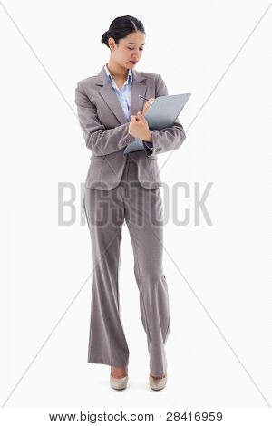 Portrait of a businesswoman taking notes against a white background