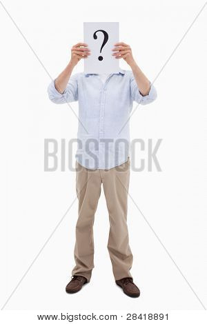 Portrait of a man holding a question mark on a paper against a white background