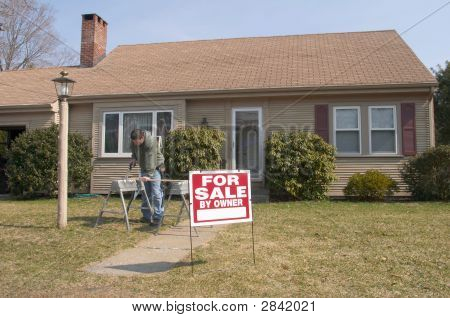 Home For Sale With Man Working