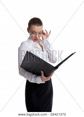 Sexy business woman look in  ledger book