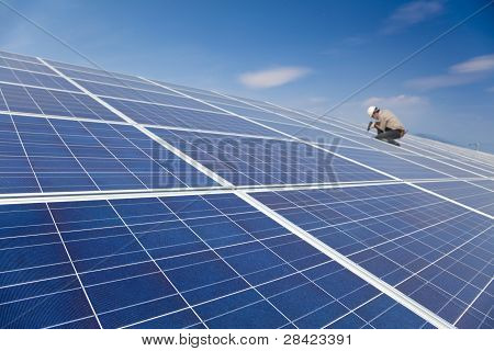 close up solar panel and professional worker
