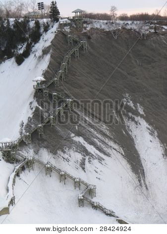 Steep stairs on a snowy mountain