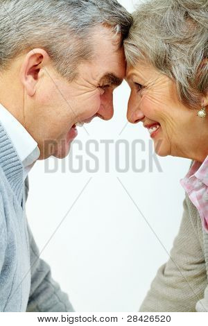 Profiles of senior woman and man face to face