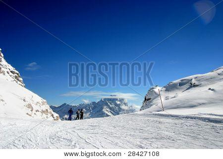 ski slope covered mountain side