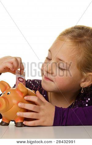 child with a piggy bank. euro sham save