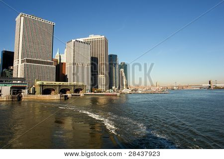 New York City - Staten Island Ferry Terminal and Brooklyn Bridge in a clear sky