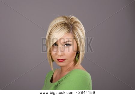 Blonde In Green Blouse And Earrings