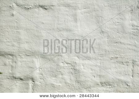 The old brick wall in plaster