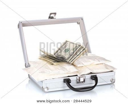 ?ocaine with money in a suitcase isolated on white