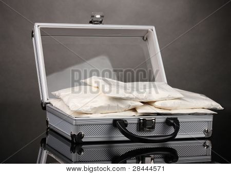 ?ocaine in a suitcase on grey background