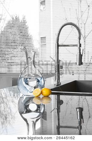 carafe of water and lemons in modern kitchen - freshness
