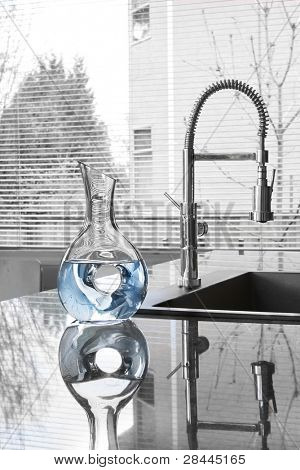 carafe of water in modern kitchen - partially toned image